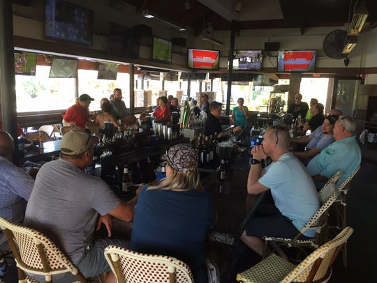 People gathered at Bokamper's Sports Bar & Grill in