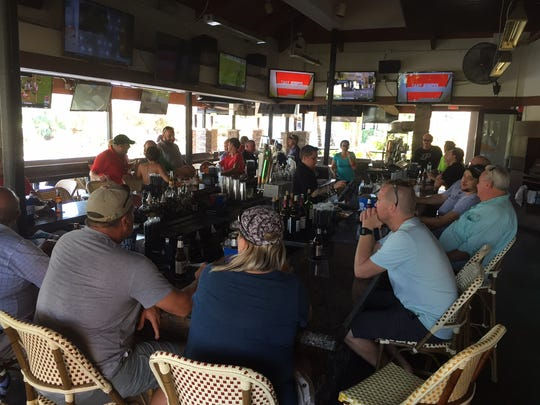 People gathered at Bokamper's Sports Bar & Grill in North Naples to watch college football on Saturday, Sept. 16, 2017. A week after Hurricane Irma hit Collier County, residents are seeking a return to normality.