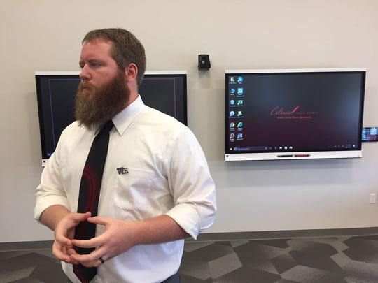 Kevin Wright, a Distance Learning Coordinator at William Penn High School, stands in front of a white board in the school's new innovation center.