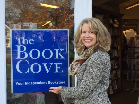 Book Cove manager Tara Lombardozzi is shown outside the Pawling business at 22 Charles Colman Blvd.