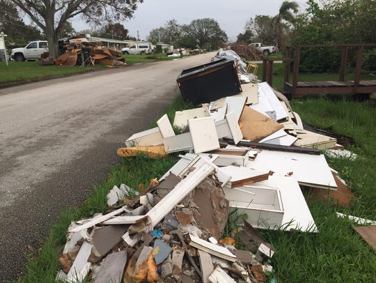 Soaked furniture and other debris caused by Hurricane