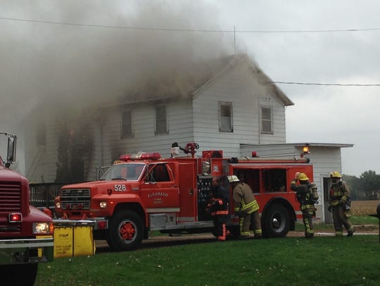 Fire crews battle a blaze at a home on Moon Road in