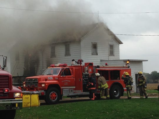 Fire crews battle a blaze at a home on Moon Road in the town of Eldorado