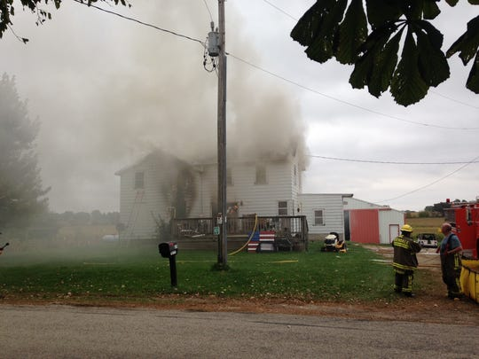 Firefighters battle a house fire on Friday, Oct. 6 at N8375 Moon Road in the town of Eldorado, Fond du Lac County.