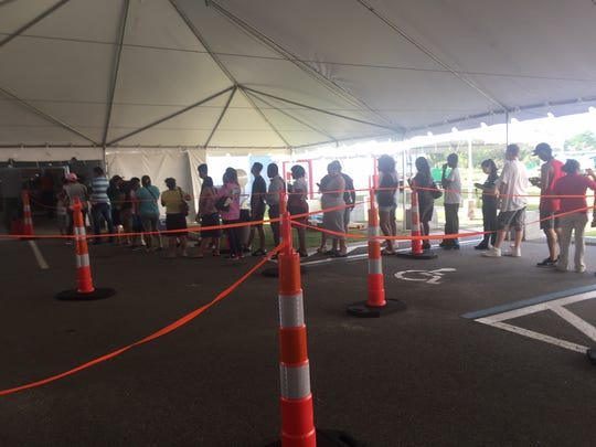 People line up for emergency food assistance at Cocoa Expo Sports Center.
