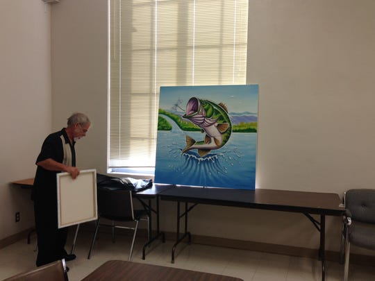 Local artist Ralph Stearns sets up some canvases at a September meeting of the Lake Wichita Revitalization Committee of a potential mural at the Lake Wichita Spillway. The group reported Tuesday the city is willing to move forward with a professional services agreement, but $13,000 for supplies are still needed.