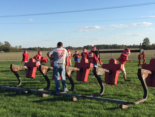 Bruce Scaggs stands on the tackle sled during Turkey Run football practice.