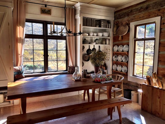 A former bridge plank became a table in Jessie Ferguson's restored homestead.