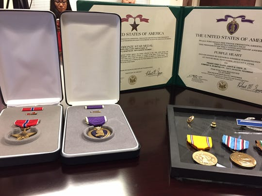 Medals like the Bronze Star and the Purple Heart were presented to the descendants of James W. Davis Jr. who died during the invasion of Normandy.