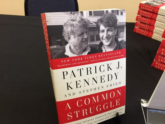 Former U.S. Rep. Patrick Kennedy signed copies of his