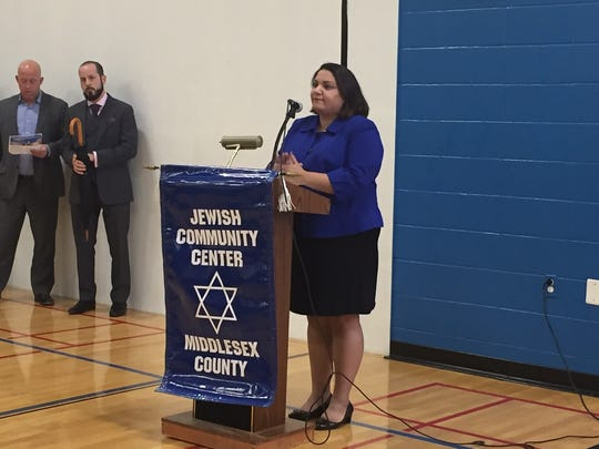 Cantor Aviva Marer, from Temple Emanu-El, who led the group in the singing of the national anthem.
