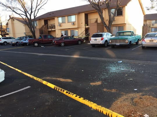 Broken glass is seen on the parking lot of the Home Suites Apartments on North McCarran Boulevard and East Lincoln Way. Spark police were investigating a shooting at the complex on Nov. 11, 2017.