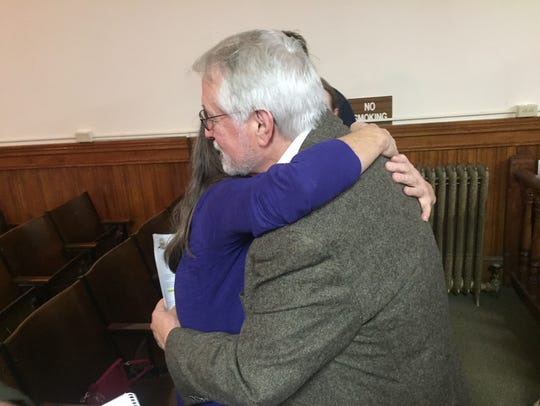 Leonard Higgins receives a hug following his two-day trial in Chouteau County.