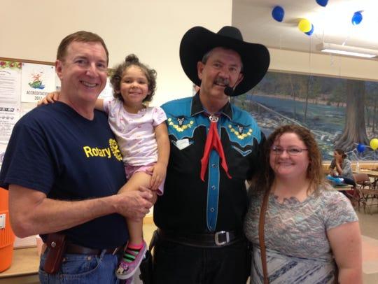 "Andy with his granddaughter Marlie Rae, ""Cowboy Doug"