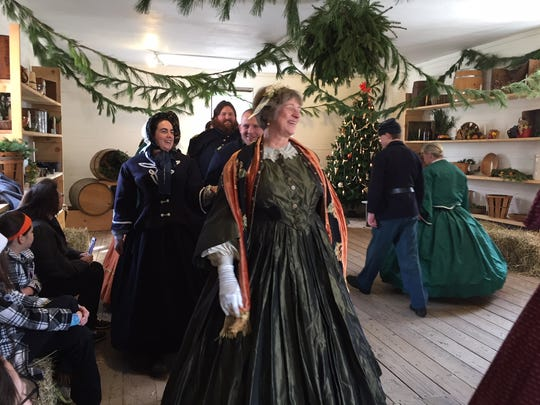 """Caller Sue Dupre leads the dancers at the Officers Ball Solders at """"Winter on the Home Front: A Civil War Christmas"""" at Historic Speedwell in Morristown."""