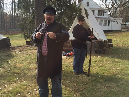 First Sergeant Greg Belcastro of the 7th NJ Regiment explains to the crowd and answer questions about how long it took for a soldier to fire their musket during the Civil War.