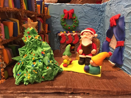 Santa Claus reads to his elves at the 2017 Gingerbread