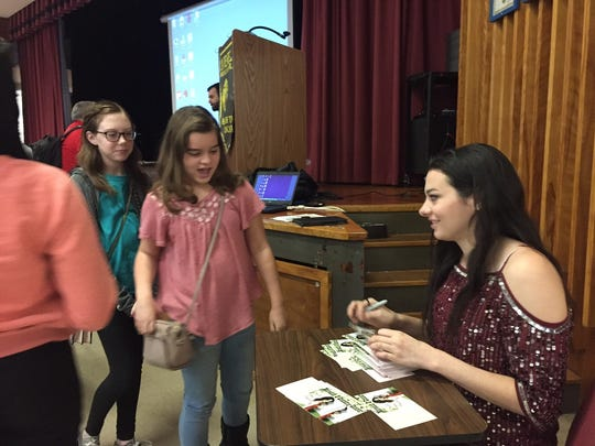 Seventh graders at Avenel Middle School got signed autographs from singer/songwriter Meredith O'Connor.