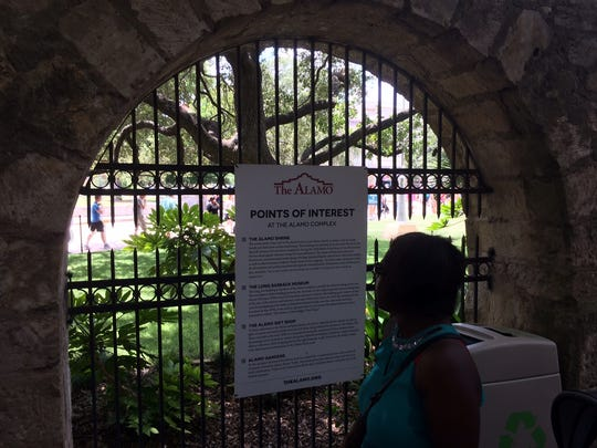A sign pointing out Alamo highlights to visitors.
