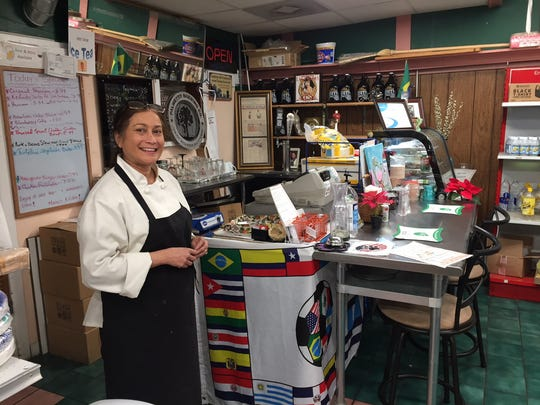 "Maria Gomes, co-owner of the Drop-In Store on North Main Street, opened up for business as usual despite the snow on Wednesday. ""Usually when it snows like this we're pretty busy,"" she said. The business is a combination restaurant and convenience store, and Gomes lives within walking distance."