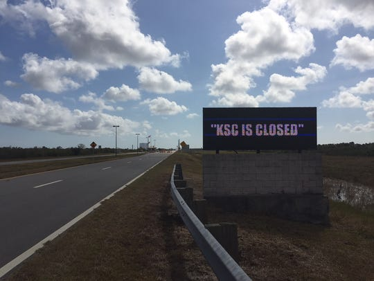 Signs outside Kennedy Space Center announced its status