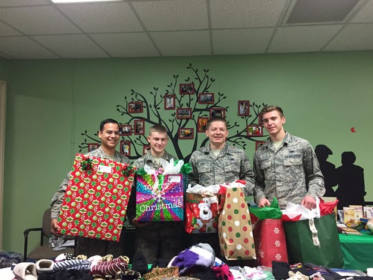 Volunteers from Dyess AFB deliver Christmas gifts to the elderly or disabled clients of Friends For Life.