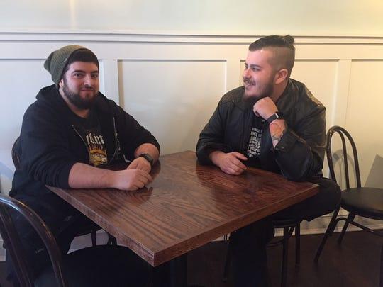 Tyler Serenelli and Matt Salvitti sit in their new