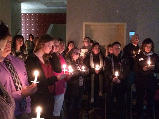 Friends and supporters light candles Friday in honor