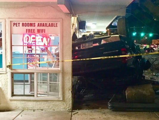 Driver hurt in rollover crash into Reno hotel