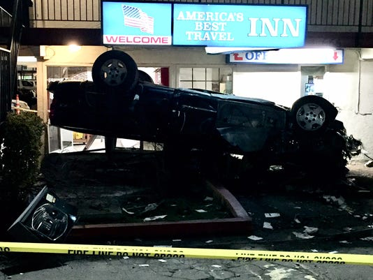 Driver hurt in rollover crash into Reno hotel