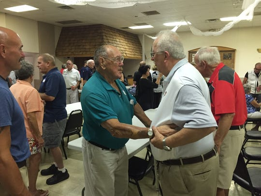 Former Marion Catholic Principal Fran Voll, right,
