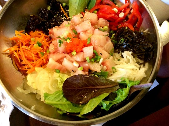 The sashimi bowl features a bright medley of fresh
