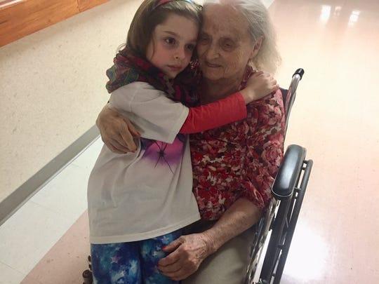 Helen Harney enjoys a visit from her great-granddaughter, Emmylou.