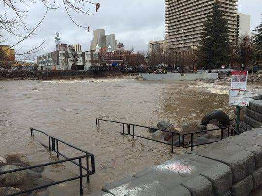 The Truckee River overflows onto the sidewalk in downtown Reno on March 22, 2018.