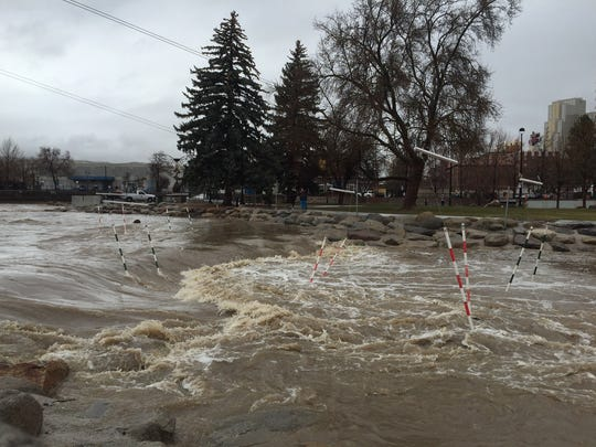 A full Truckee River is shown flowing through downtown Reno on March 22, 2018.