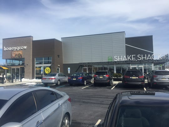 Shake Shack and honeygrow share a building and parking