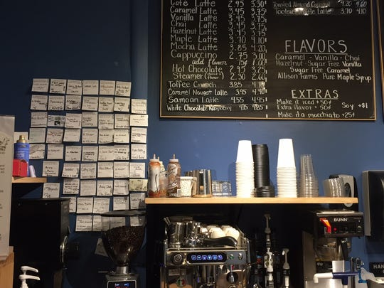 The pay-it-forward wall (left) has become a fixture behind the counter at Swatara Coffee Co. in Jonestown.