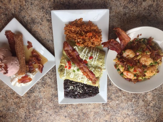 Bacon is king of Restaurant Week in Collingswood. Tortilla Press will feature Shrimp, Jalapeno and Bacon Paella served over saffron rice (from left) and Chicken & Bacon Enchiladas served with , creamy tomatillo salsa, Mexican crème with black beans and red rice. Finish off your meal with a Maple Bacon Churro Sundae.