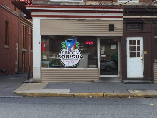 The storefront to Rincon Boricua, specializing in Puerto Rican cuisine, right next door to the Lebanon Farmers Marker on South 8th Street.