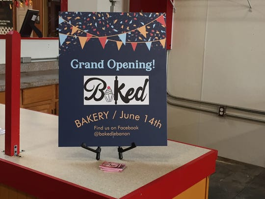 A sign at the stand where a new bakery called Baked will be opening in June at the Lebanon Farmers Market.
