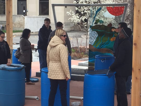 Participants at the 2017 Democrat and Chronicle Earth Day Rain Barrel Workshop.
