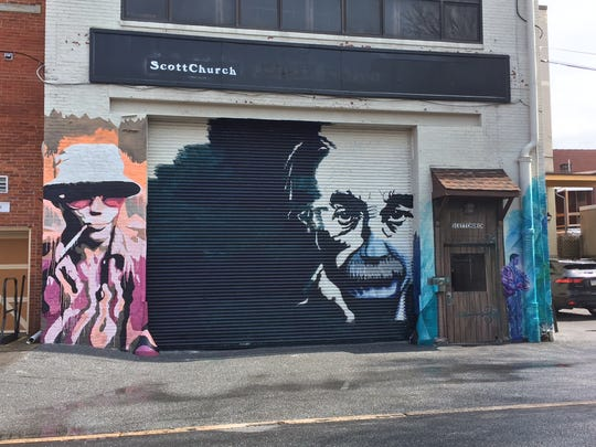 Albert Einstein takes up residence at 38 S. Gannon St., next to the farmers market, between a mural of Hunter S. Thompson and another painting.