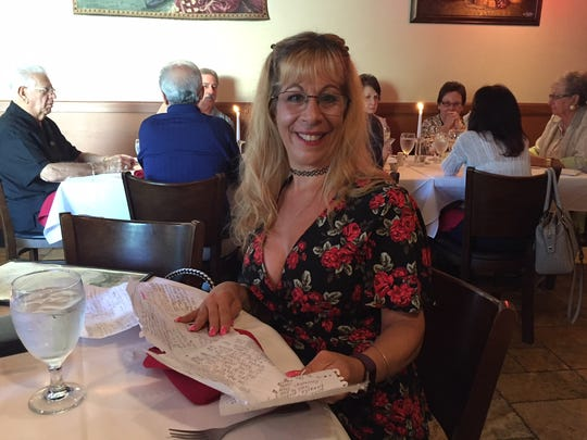 """Laura Prevete, self-proclaimed to be obsessed with """"Murder on the Space Coast"""" shows off her pages and pages of questions she had for journalist John A. Torres and retired detective Sid LaDow."""