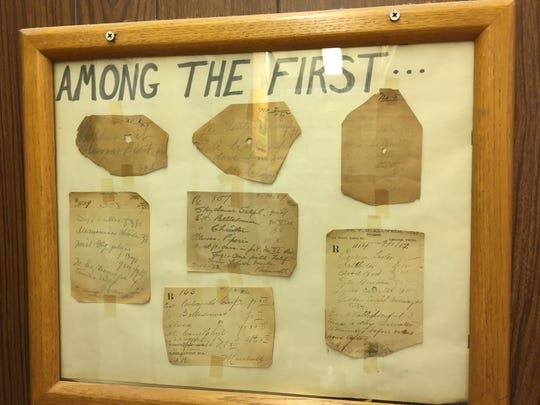 A frame at Loehle Pharmacy displays prescriptions written around 1882 or '83, the first years the drugstore was in operation.