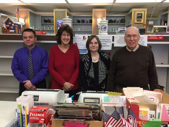From left to right, Scott Karli, Beverly Whitman, Rebecca Arnold and owner Greg Arnold, together on the final day of operations for Loehle Pharmacy.