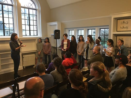Dena Blizzard, founder of Ladies OUT LOUD, addresses the program's first graduating class of young women at the Moorestown Community House.