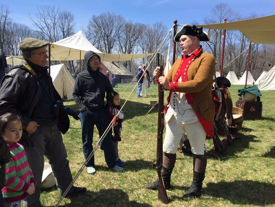 A re-enactor demonstrates how to use a rifle and bayonet at the Grand Encampment at Jockey Hollow on April 21-22, 2018.