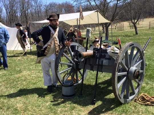 A re-enactors demonstrate how to shoot a cannon and its effects at the Grand Encampment at Jockey Hollow on April 21-22, 2018.