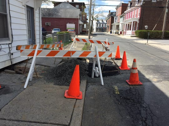 A sinkhole formed out front of a property on S. 7th