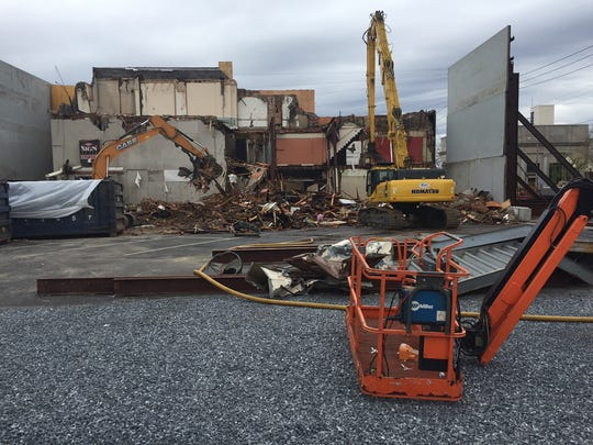 One machine was busy Monday morning at 109 East Main Street. Cleanup is the only activity so far on day four of the project.